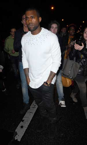 "<div class=""meta ""><span class=""caption-text "">Kanye West arrives for the Givenchy's fashion house presentation for Women's Fall-Winter, ready-to-wear 2013 fashion collection, during Paris Fashion week, Sunday, March 4, 2012.  ((AP Photo/Zacharie Scheurer))</span></div>"