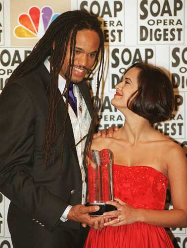 Keith Hamilton Cobb and Sydney Penny of &#34;All My Children&#34; hold their award for Hottest Romance at the Twelfth Annual Soap Opera Digest Awards Wednesday night, Feb. 14, 1996, in Beverly Hills, Calif. <span class=meta>( AP Photo&#47;Mark J. Terrill)</span>