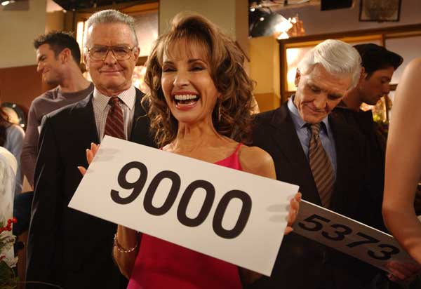 Susan Lucci, center, who plays the role of Erica Kane, Ray MacDonnell, left, who plays the role of Dr. Joe Martin, and David Canary, right, who plays the role of both Adam and Stuart Chandler, in the ABC daytime drama, &#34;All My Children&#34;, celebrate the taping of the 9,000th espisode of the show, Wednesday, Nov. 17, 2004, in New York. The cast of All My Children held up signs marking the number of episodes they have been in up to the present. Susan Lucci has starred in all 9,000 episodes and will celebrate thirty-five years on the show in January 2005 . <span class=meta>(AP Photo&#47;Jennifer Szymaszek)</span>