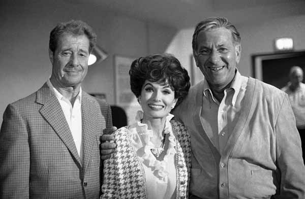 Don Ameche, left, and Ann Blyth, center, as guest stars, join Jack Klugman on the set for an episode of the television series, Quincy, June 22, 1978, Los Angeles, Calif. Klugman plays the title role, a medical examiner, in Quincy, after five years in The Odd Couple. Klugman was anxious for the series not to turn into just another detective show. What I like about Quincy is that you dont see forensic medicine anywhere else on television, he says. Youre not just another cop. (AP Photo/Nick Ut)