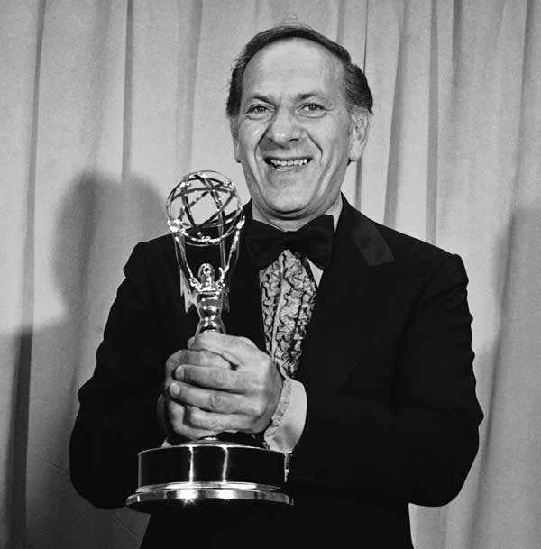 Jack Klugman holds his Emmy for his role in The Odd Couple presented at the 25th Emmy Awards Banquet for outstanding continued performance by an actor in a leading role in a comedy series, May 20, 1973, Los Angeles, Calif. (AP Photo/David F. Smith)