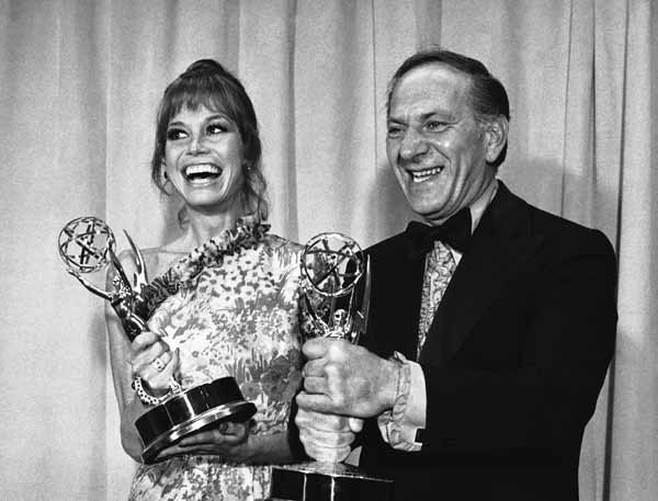 "Mary Tyler Moore and Jack Klugman hold the Emmys they were awarded at the Television Academy's annual awards presentations for best actress and actor of a comedy series in Los Angeles, May 20, 1973. Miss Moore won hers for the ""Mary Tyler Moore Show"" and Klugman for ""The Odd Couple. (AP Photo/David F. Smith)"