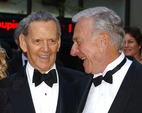 "Television's famed ""Odd Couple,"" Tony Randall, left, and Jack Klugman, right, arrive at NBC's 75th anniversary celebration, Sunday, May 5, 2002, at New York's Rockefeller Center. The festivities, which celebrate America's first broadcasting network, will be telecast live from NBC's Studio 8H. Randall died on May 17, 2004. He was 84. (AP Photo/Ron Frehm)"