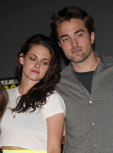 "<div class=""meta image-caption""><div class=""origin-logo origin-image ""><span></span></div><span class=""caption-text"">Kristen Stewart and Robert Pattinson attend ""The Twilight Saga: Breaking Dawn - Part 2"" Panel at Comic-Con on Thursday, July 12, 2012 in San Diego, Calif.  (Photo by John Shearer/Invision/AP)</span></div>"
