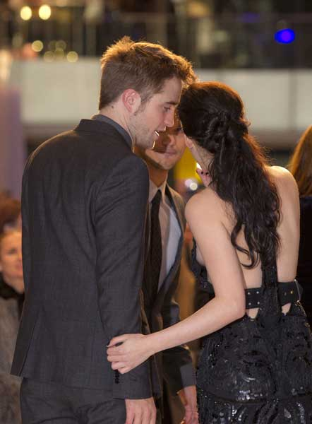 US actress Kristen Stewart holds British actor Robert Pattinson, left, as they arrive at the UK film premiere of &#39;Twilight Breaking Dawn Part 1&#39; at Westfield Stratford in east London, Wednesday, Nov. 16, 2011.  <span class=meta>(AP Photo&#47;Joel Ryan)</span>