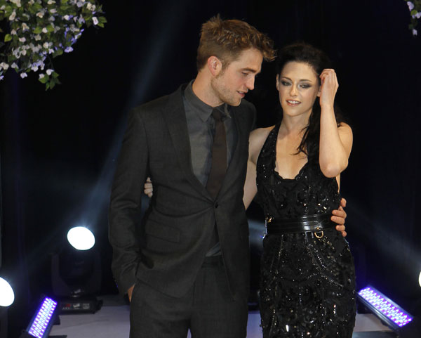 British actor Robert Pattinson, left, and US actress Kristen Stewart arrive for the UK film premiere of &#39;Twilight Breaking Dawn Part 1&#39; at Westfield Stratford in east London, Wednesday, Nov. 16, 2011.  <span class=meta>(AP Photo&#47;Joel Ryan)</span>