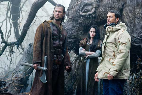 This film image released by Universal Pictures shows actors Chris Hemsworth, from left, Kristen Stewart and director Rupert Sanders on the set of &#34;Snow White and the Huntsman&#34;.  <span class=meta>(AP Photo&#47;Universal Pictures, Alex Bailey)</span>