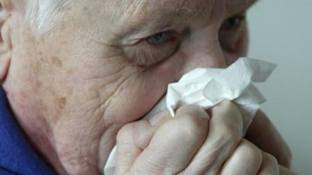 (FILE) An elderly patient blows his nose on Friday, January 14, 2005.