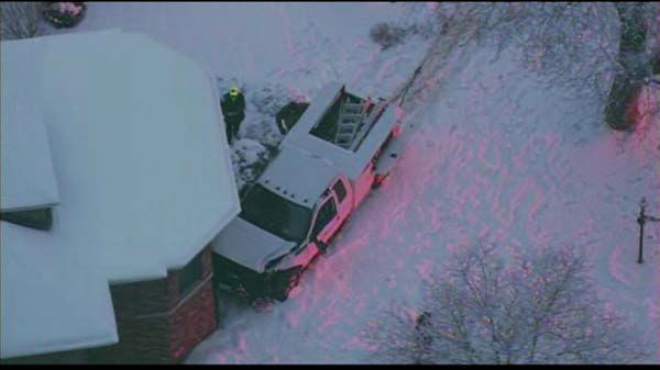 A snow plow struck a Pace bus Friday morning and sent it into the front yard of a home in Glenview.  <span class=meta>(WLS Photo)</span>
