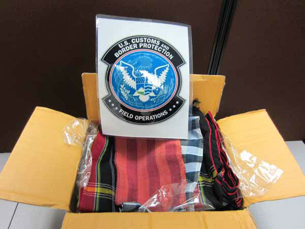 &#34;The contents of the parcels were invoiced as &#39;Hmong Dresses&#39; and contained 38 pieces of decorative cloth. CBP officers tested the cloth resulting in a positive reaction for opium. The 38 pieces of opium saturated cloth had a combined weight of 15.06 pounds, valued at &#36;238,682. The shipment was destined for an address in Wisconsin.&#34; &#40;Info from US Customs press release&#41; <span class=meta>(CBP)</span>