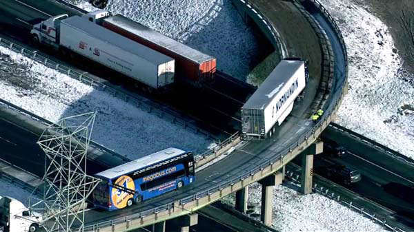 A Megabus struck a guardrail as it tried to pass a disabled semi-tractor trailer on I-90 in Lake Station, Ind.  <span class=meta>(WLS Photo)</span>