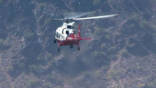A Chicago man and his 5-year-old son were airlifted from Camelback Mountain in Arizona after they got lost on Cholla Trail. <span class=meta>(WLS Photo)</span>