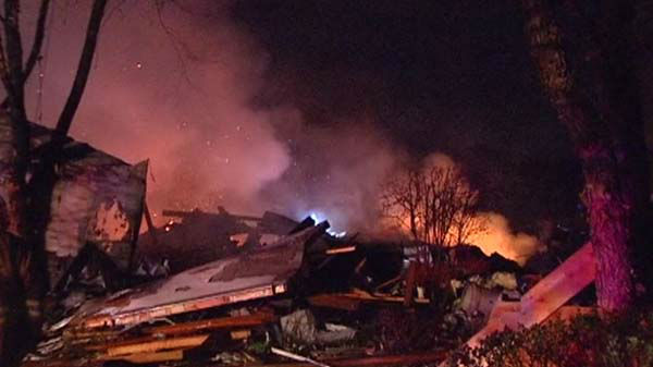 "<div class=""meta ""><span class=""caption-text "">A home exploded and caught fire in Long Grove late Friday, April 25, 2014. That house was leveled, and 50 others in the area were damaged.   (WLS Photo)</span></div>"