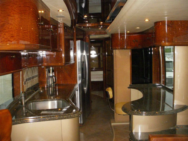 The U.S. Marshals Service is accepting bids on a luxury motor home that belonged to Rita Crundwell. The 59-year-old Dixon resident is accused of misappropriating more than $53 million since 1990 to help support a lavish lifestyle and her nationally renowned horse breeding operation.  Bidding for the 2009 Liberty Coach Motor Home starts at $1 million and continues until August 1, 2012.  If Crundwell is found guilty, net proceeds from the sales will go toward restitution for the city of Dixon.