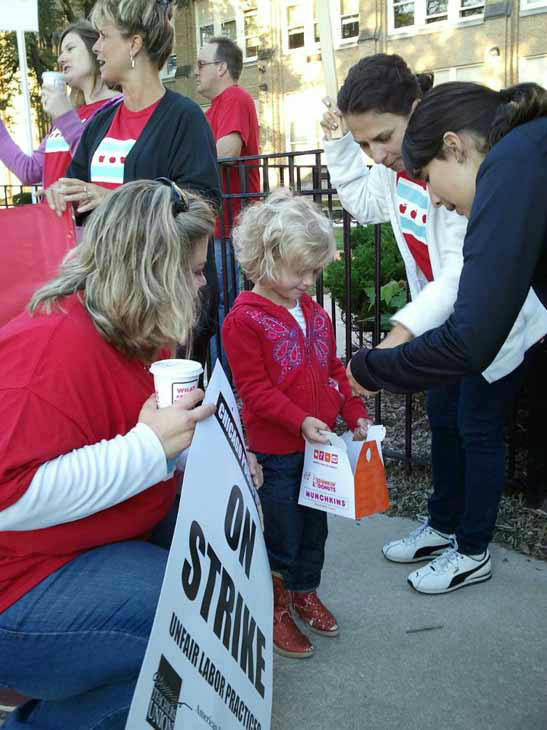"Viewer-submitted photo via useeit.abc7chicago.com: ""Isabella Saineghi, a brand new student at Oriole Park Elementary, stopped by the picket line to offer her teachers a treat."""