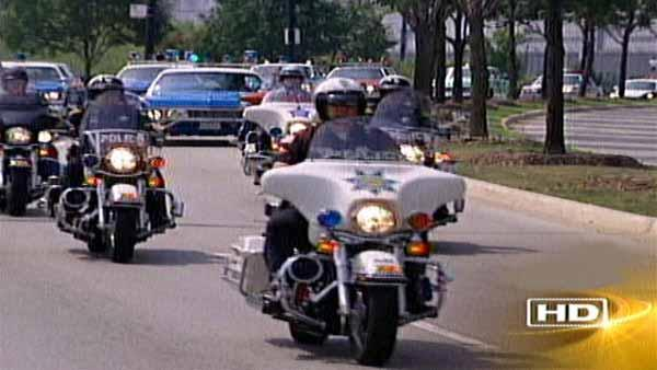 The riders formed a procession more than two miles long consisting of officers on motorcycles, followed by vintage squad cars from various police departments.