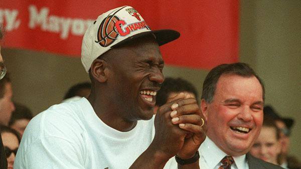 Chicago's Bulls' Michael Jordan, left, and Mayor Richard M. Daley enjoy the NBA championship celebration at Chicago's Grant Park Tuesday, June 18, 1996, where thousands of fans gathered for a personal pledge of allegiance to their hometown heroes.