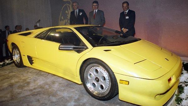 Chrysler and Lamborghini executives look over the new Lamborghini Diablo after it was unveiled at a preview for the upcoming Chicago Auto Show, Feb. 9, 1990.  (AP Photo/Jonathan Kirn)