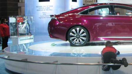 A toddler climbs on the display of the 2013 Toyota NS4 Hybrid Concept at the 2012 Chicago Auto Show, located at McCormick Place in Chicago on Monday, Feb. 13, 2012.