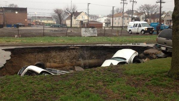 Three cars in sinkhole at 96th and Houston.
