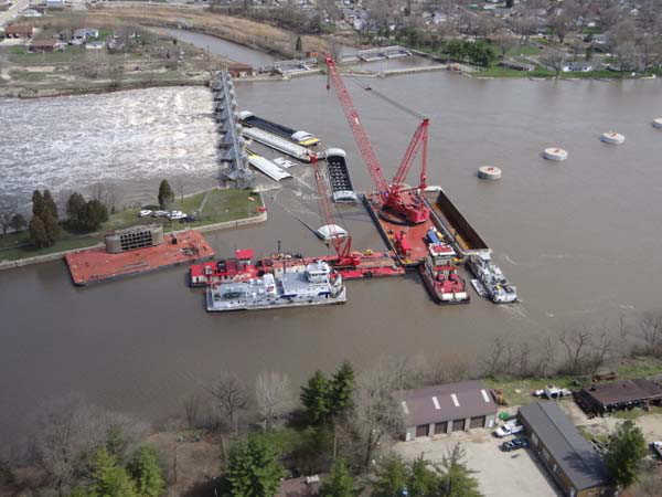 "<div class=""meta image-caption""><div class=""origin-logo origin-image ""><span></span></div><span class=""caption-text"">A crane known as the HERCULES unloads cargo from one of the submerged barges near the Marseilles Dam in Marseilles, Ill., April 24, 2013. Salvage operations will continue to remove the remaining barges. Coast Guard photo by Petty Officer 3rd Class John Schleicher (Photo/Chief Petty Officer Alan Haraf)</span></div>"