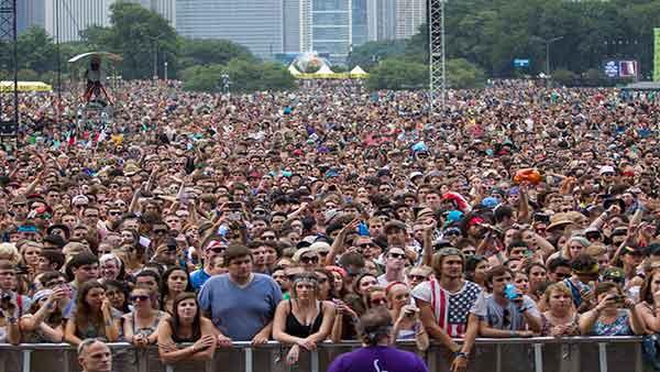 Fans at Lollapalooza Festival wait for the next act to begin in Chicago, F
