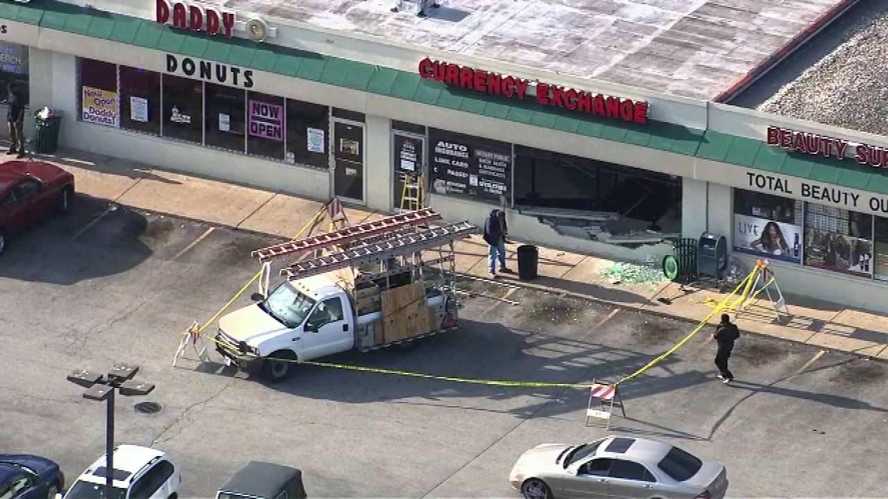 A car has crashed into a currency exchange in south suburban Richton Park.
