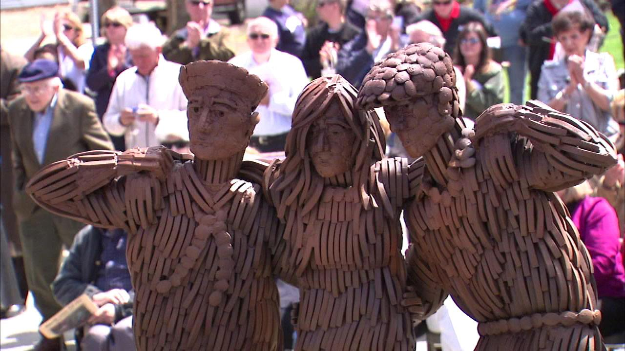 A statue honoring the victims of the 1946 Naperville train crash was unveiled Saturday near the Loomis Street Crossing.