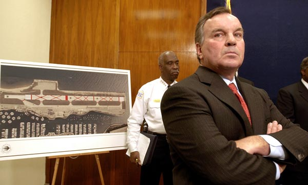 Mayor Richard Daley listens to questions during...