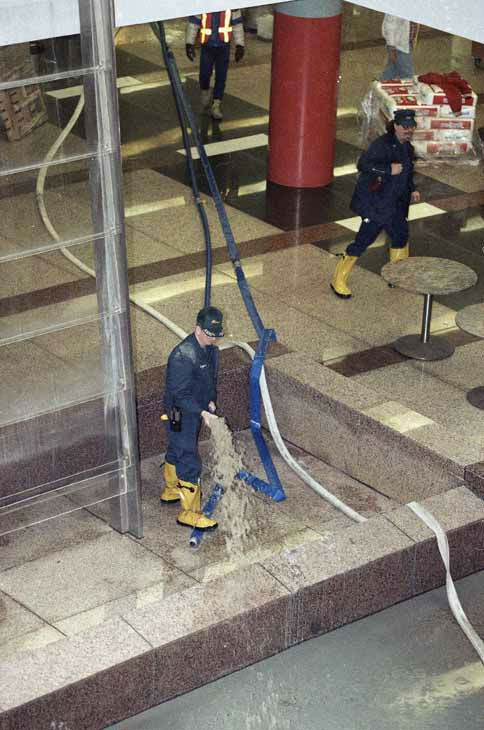 "<div class=""meta ""><span class=""caption-text "">Water is pumped out of the lower level of the State of Illinois building, April 15, 1992. (AP Photo)</span></div>"