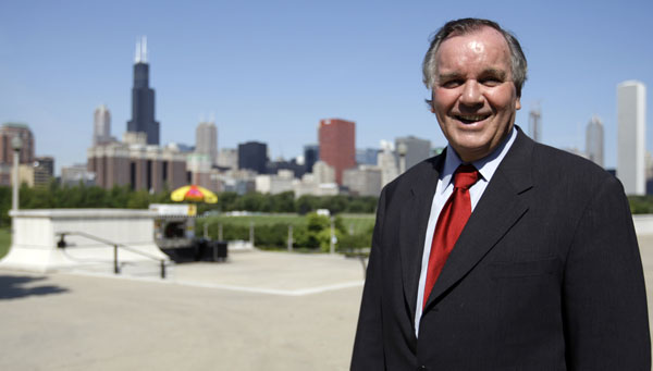 Chicago Mayor Richard M. Daley poses with the city skyline behind him after announcing a plan to dramatically slash emissions of heat-trapping gases to three-fourths of 1990 levels by 2020 and to one-fifth of 1990 levels by 2050 as part of an effort to become one of the greenest cities in the nation at a press conference Thursday Sept. 18, 2008 in Chicago. (AP Photo/M. Spencer Green)