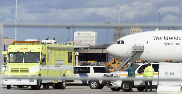Police, fire, rescue and bomb squad personnel respond to the United Parcel Service staging area at Newark Liberty International Airport where a cargo plane was searched and a suspicious package removed Friday, Oct. 29, 2010, in Newark, N.J.  (AP Photo/Joe Epstein)
