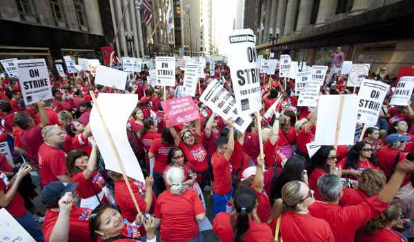 Thousands of public school teachers rally outside Chicago Public Schools district headquarters on the first day of strike action over teachers&#39; contracts on Monday, Sept. 10, 2012 in Chicago. For the first time in a quarter century, Chicago teachers walked out of the classroom Monday, taking a bitter contract dispute over evaluations and job security to the streets of the nation&#39;s third-largest city ? and to a national audience ? less than a week after most schools opened for fall. &#40;AP Photo&#47;Sitthixay Ditthavong&#41; <span class=meta>(AP Photo&#47; Sitthixay Ditthavong)</span>