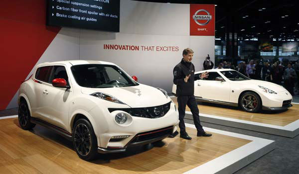 Simon Sproule, Corporate V.P. Global Marketing Communications Nissan Motor Co., talks about the 2013 Juke Nismo, left, and the 2014 370Z Nismo at the Chicago Auto Show Thursday, Feb. 7, 2013, in Chicago. &#40;AP Photo&#47;Charles Rex Arbogast&#41; <span class=meta>(AP Photo&#47; Charles Rex Arbogast)</span>