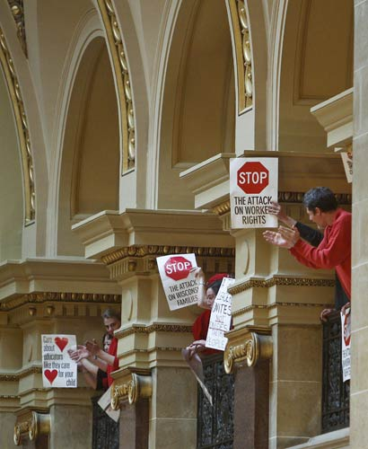 "<div class=""meta image-caption""><div class=""origin-logo origin-image ""><span></span></div><span class=""caption-text"">Protestors to Wisconsin Gov. Scott Walker's bill to eliminate collective bargaining rights for many state workers demonstrate in the rotunda at the State Capitol in Madison, Wis., Thursday, Feb. 17, 2011. (AP Photo/Andy Manis)</span></div>"