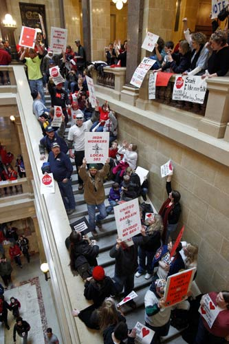 Protestors to Wisconsin Gov. Scott Walker's bill to eliminate collective bargaining rights for many state workers demonstrate in the rotunda at the State Capitol in Madison, Wis., Thursday, Feb. 17, 2011. (AP Photo/Andy Manis)