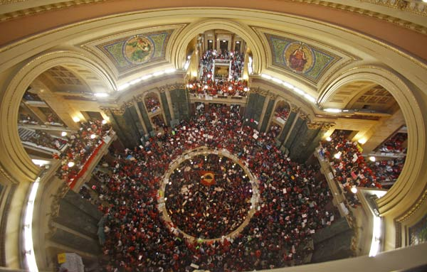 Protestors to Wisconsin Gov. Scott Walker's bill to eliminate collective bargaining rights for many state workers pack the rotunda at the State Capitol in Madison, Wis., Thursday, Feb. 17, 2011. (AP Photo/Andy Manis)