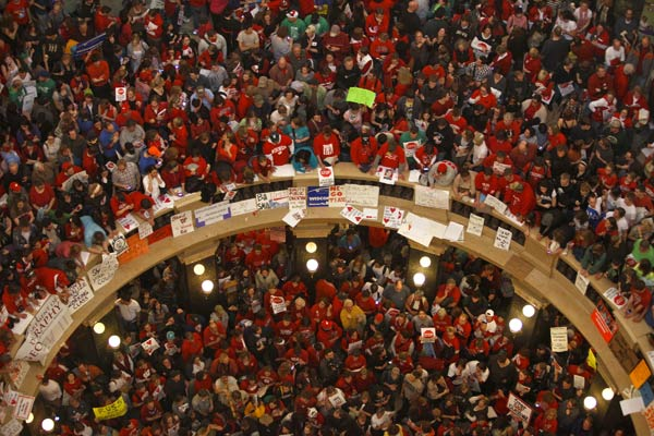"<div class=""meta image-caption""><div class=""origin-logo origin-image ""><span></span></div><span class=""caption-text"">Protestors of Wisconsin Gov. Scott Walker's bill to eliminate collective bargaining rights for many state workers pack the rotunda at the State Capitol in Madison, Wis., Thursday, Feb. 17, 2011. (AP Photo/Andy Manis)</span></div>"