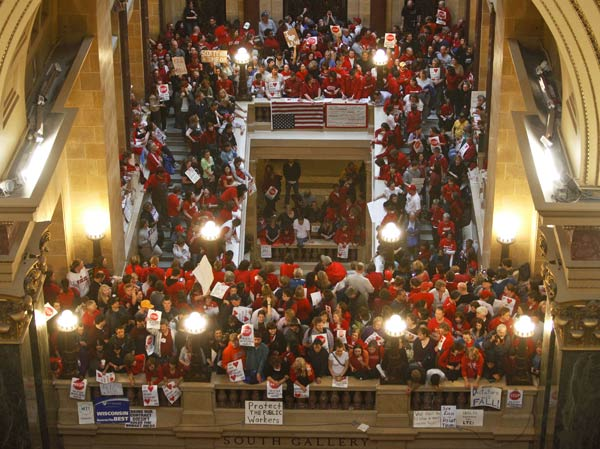 Protestors to Wisconsin Gov. Scott Walker's bill...