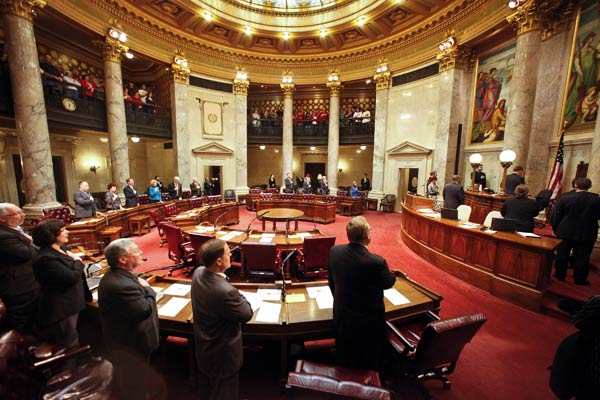 Wisconsin Republican state senators stand as...