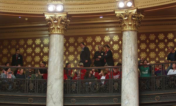 Protestors fill the gallery of the Wisconsin...
