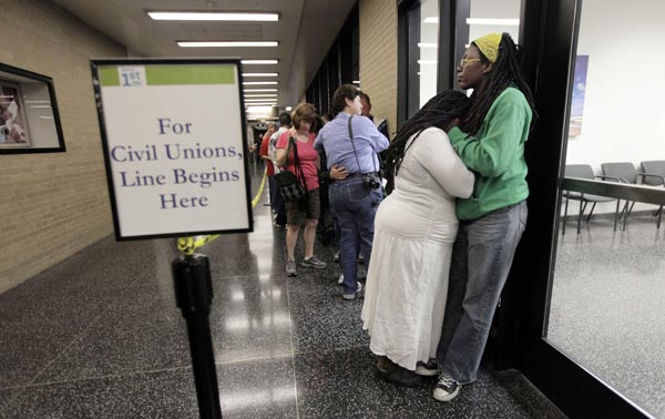 "<div class=""meta image-caption""><div class=""origin-logo origin-image ""><span></span></div><span class=""caption-text"">Lakeesha Harris and Janean Watkins, right, wait in line outside the Cook County Office of Vital Records to obtain a civil union license, Wednesday, June 1, 2011, in Chicago. The couple, who have been together for ten years, arrived at the Cook County Building at midnight to be first in line as Illinois' new civil union law took effect.  (AP Photo/M. Spencer Green)</span></div>"