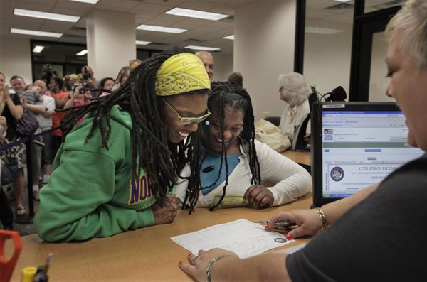 "<div class=""meta image-caption""><div class=""origin-logo origin-image ""><span></span></div><span class=""caption-text"">Janean Watkins, left, and Lakeesha Harris smile as they obtain a civil union license from Louisa Nicotera at the Cook County Office of Vital Records, Wednesday, June 1, 2011, in Chicago.  (AP Photo/M. Spencer Green)</span></div>"