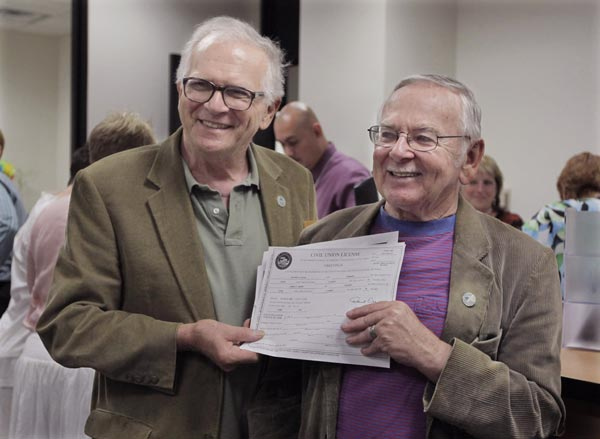 "<div class=""meta image-caption""><div class=""origin-logo origin-image ""><span></span></div><span class=""caption-text"">Patrick Bora,73, left, and his partner Jim Darby, 79, show off their civil union license at the Cook County Office of Vital Records, Wednesday, June 1, 2011, in Chicago.  (AP Photo/M. Spencer Green)</span></div>"