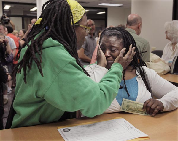 "<div class=""meta image-caption""><div class=""origin-logo origin-image ""><span></span></div><span class=""caption-text"">Janean Watkins, left, and Lakeesha Harris embrace as they obtain a civil union license from the Cook County Office of Vital Records, Wednesday, June 1, 2011, in Chicago.  (AP Photo/M. Spencer Green)</span></div>"