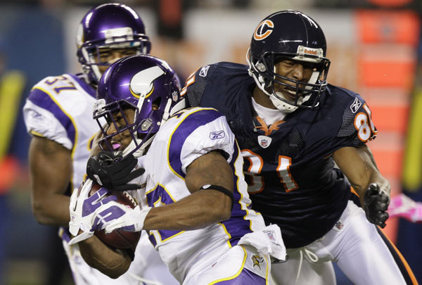 Minnesota Vikings wide receiver Percy Harvin is tackled by Chicago Bears wide receiver Sam Hurd (81) in the first half of an NFL football game, Sunday, Oct. 16, 2011, in Chicago. (AP Photo/Nam Y. Huh)