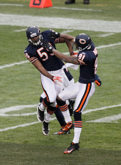 Chicago Bears' Patrick Trahan (59) celebrates his tackle after kickoff with teammate Sam Hurd (81) in the first half of an NFL football game against the Kansas City Chiefs in Chicago, Sunday, Dec. 4, 2011. (AP Photo/Kiichiro Sato)