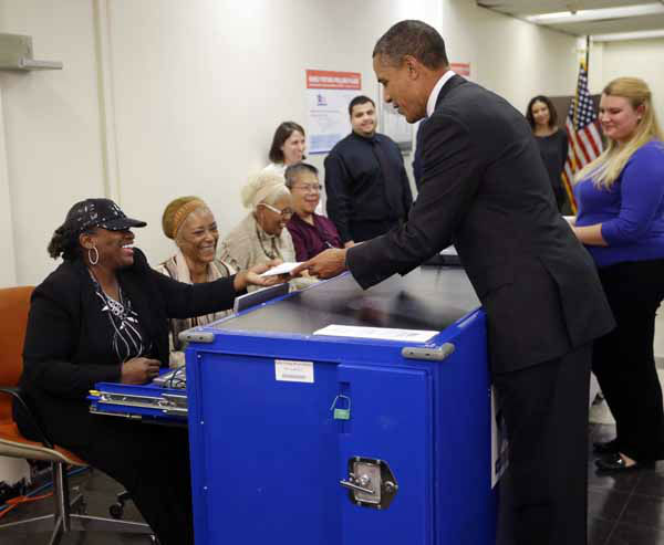 "<div class=""meta ""><span class=""caption-text "">President Barack Obama, right, turns in his ballot receipt to election official Marie Holmes, left, as he prepares to cast his vote, during early voting, in the 2012 election at the Martin Luther King Community Center, Thursday, Oct. 25, 2012, in Chicago. (AP Photo/Pablo Martinez Monsivais) (AP Photo/ Pablo Martinez Monsivais)</span></div>"