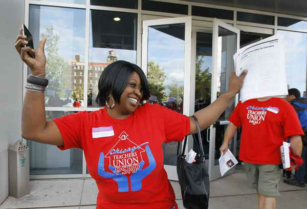 Tennille Evans, a member of the Chicago Teachers Union&#39;s House of Delegates, celebrates after the delegates voted to suspend the strike against the school district Tuesday, Sept. 18, 2012, in Chicago. The city&#39;s teachers agreed to return to the classroom after more than a week on the picket lines, ending a spiteful stalemate with Mayor Rahm Emanuel that put teacher evaluations and job security at the center of a national debate about the future of public education. &#40;AP Photo&#47;Charles Rex Arbogast&#41; <span class=meta>(AP Photo&#47; Charles Rex Arbogast)</span>