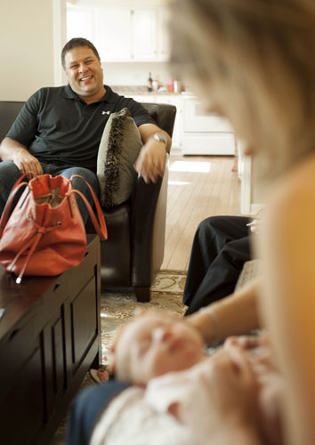 "<div class=""meta ""><span class=""caption-text "">Mike Jordan, left, watches his wife Emily Jordan hold their six-day-old daughter Elle Cynthia Jordan on Wednesday, Sept. 5, 2012 in Naperville, Ill. After Emily Jordan underwent a radical hysterectomy, she and her husband took up an offer from her mother Cindy Reutzel to act as a surrogate for their child.  (AP Photo/Sitthixay Ditthavong)</span></div>"